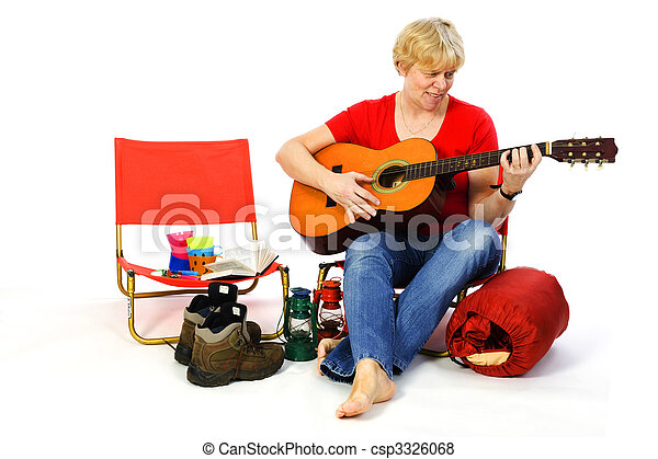 Playing guitar at the campground - csp3326068