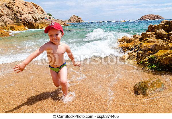 playing on a sea coast - csp8374405