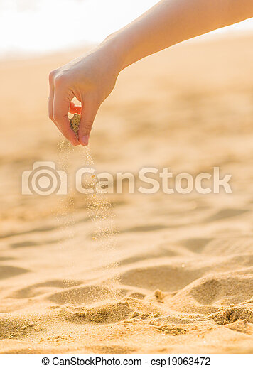 playing sand on the beach - csp19063472