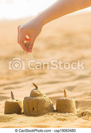 playing sand on the beach - csp19063480