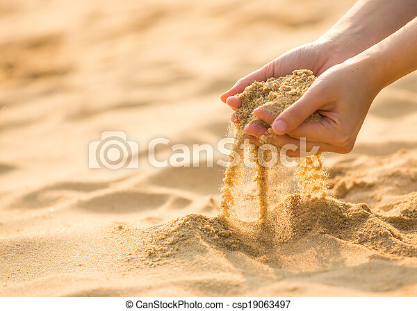playing sand on the beach - csp19063497