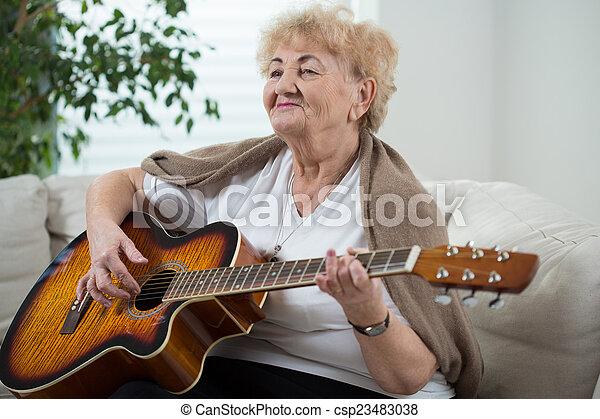 Playing the guitar - csp23483038