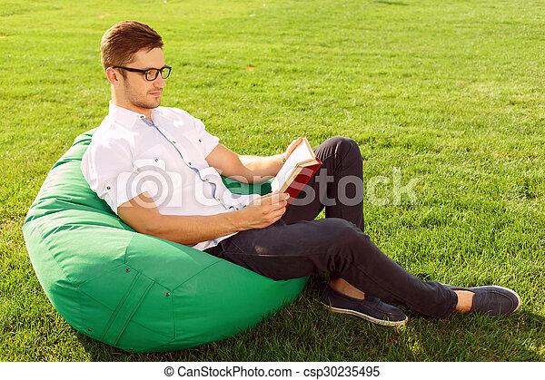 Pleasant guy relaxing. - csp30235495