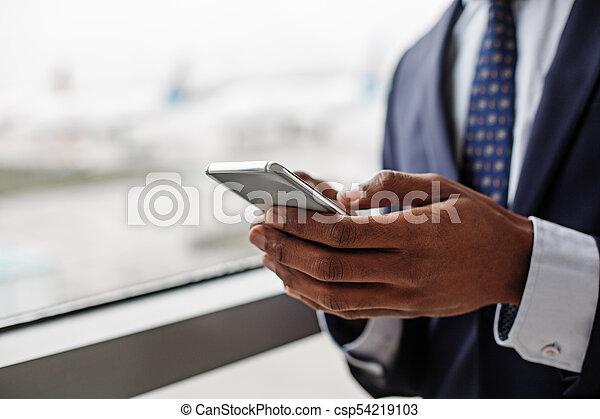 Pleasant qualified entrepreneur is using mobile phone - csp54219103