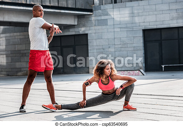 Pleasant young woman working out with her boyfriend - csp63540695