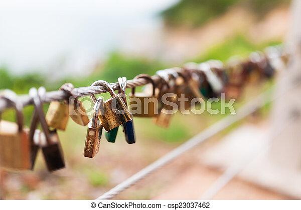 Plenty of master key locked along the wall - csp23037462