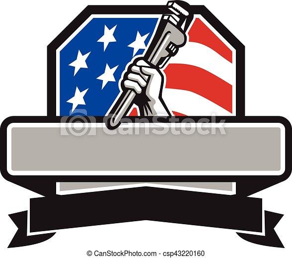 La mano de fontanero sosteniendo la llave de la llave inglesa de EE.UU - csp43220160