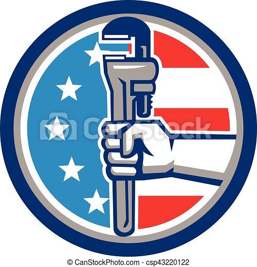 La llave inglesa de tubería de los EE.UU. en un círculo retro - csp43220122