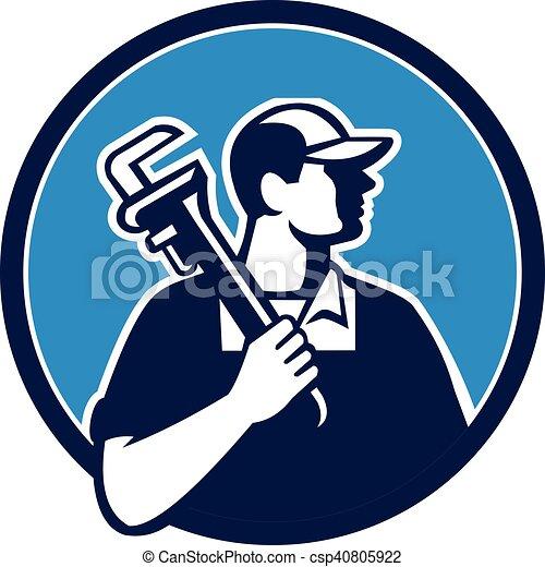 Plumber sujetando llave inglesa retro - csp40805922
