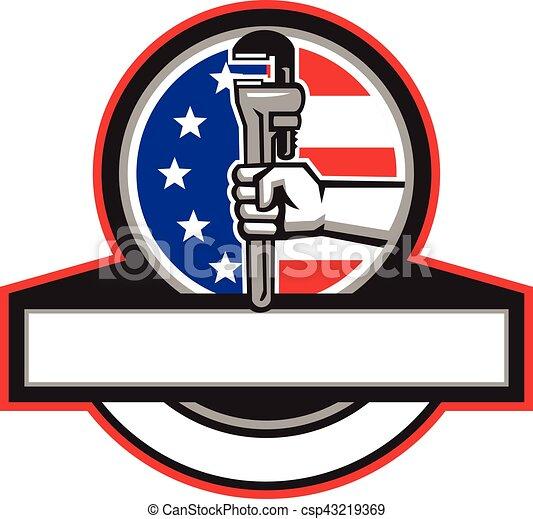 La mano de fontanero sosteniendo bandera de la llave inglesa en círculo retro - csp43219369