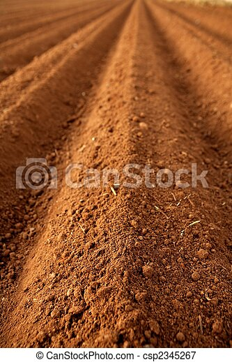 Ploughed red clay soil agriculture fields  - csp2345267