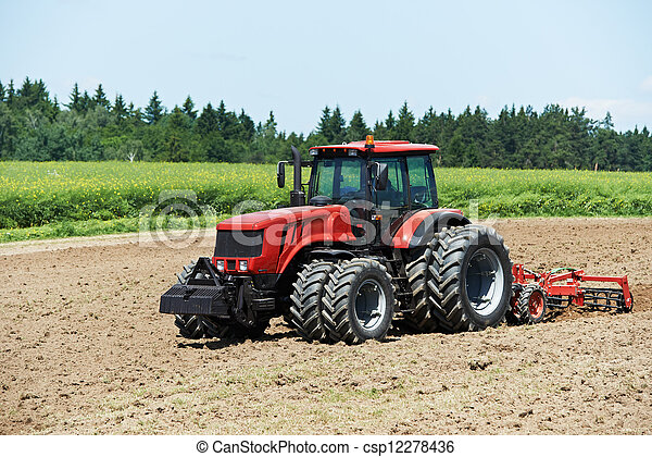 Ploughing tractor at field cultivation work - csp12278436