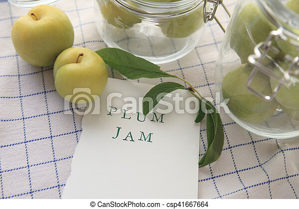 Plum jam words with glass jars - csp41667664