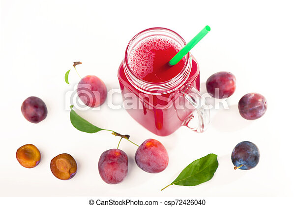 plum juice in a glass with fresh plum fruit isolated on white background - csp72426040