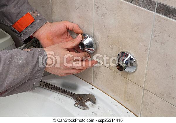 Plumber fixing faucet in a bathroom. Plumber hands fixing... stock ...