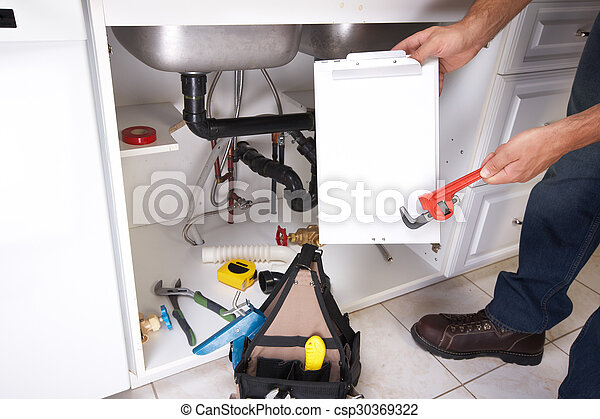 Plumber on the kitchen. - csp30369322