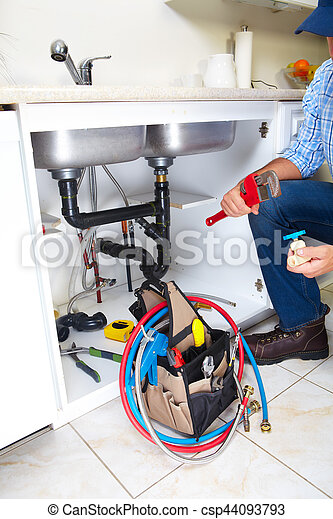 Plumber on the kitchen. - csp44093793