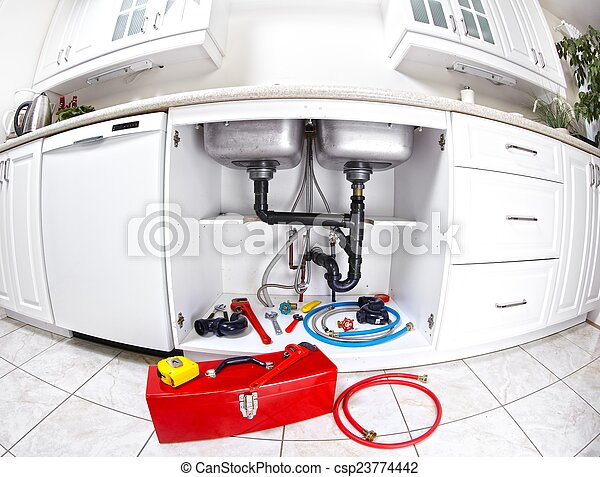Plumber tools on the kitchen. - csp23774442