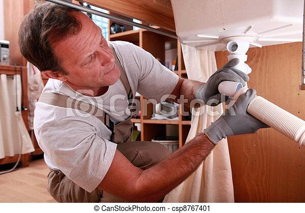 Plumbers repairing leak - csp8767401