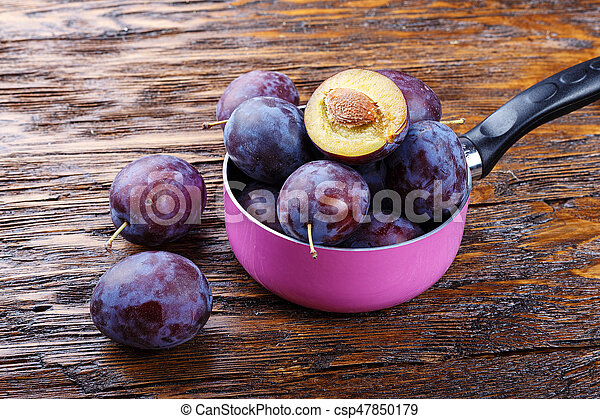 plums on the table - csp47850179