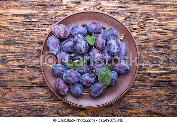 plums on the table - csp49075840