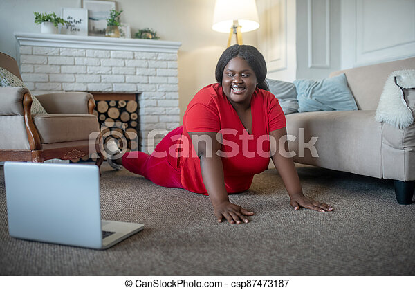Plus size african american woman smiling and standing in plank - csp87473187