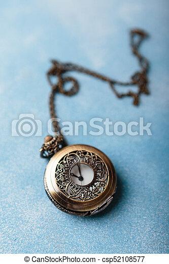 Pocket watch on blue background - csp52108577