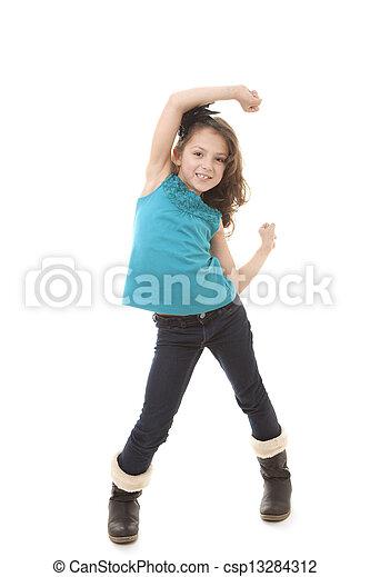 Una niña feliz bailando - csp13284312