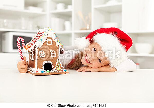 La niña se prepara para Navidad - csp7401621