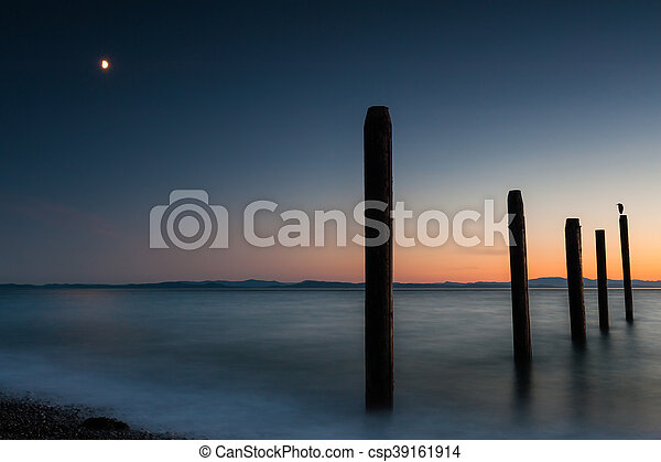 Point Roberts pilings and silky water at night time - csp39161914