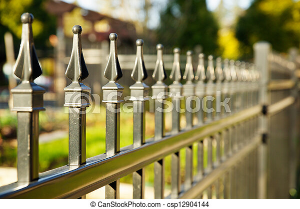 Pointed metal fence perspective - csp12904144