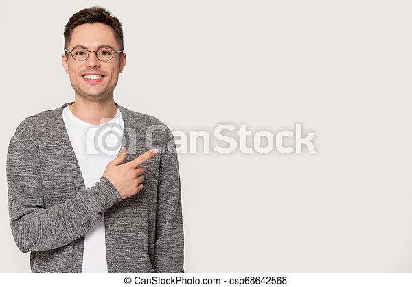 pointing, пространство, isolated, glasses, улыбается, копия, кавказец, человек - csp68642568