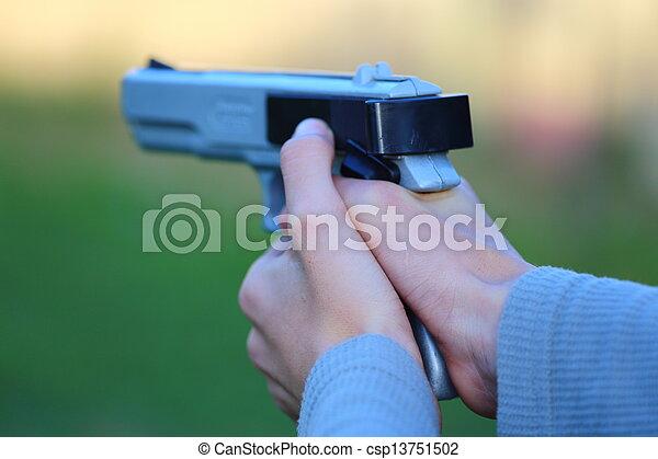 Pointing a Gun - csp13751502