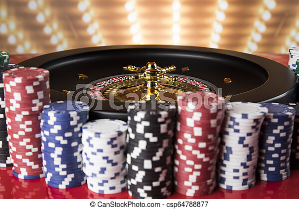 Poker Chips Roulette Wheel In Motion Casino Background Poker Chips On Gaming Table Roulette Wheel In Motion Casino Canstock