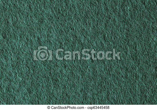 Poker table felt background in green color. - csp63445458