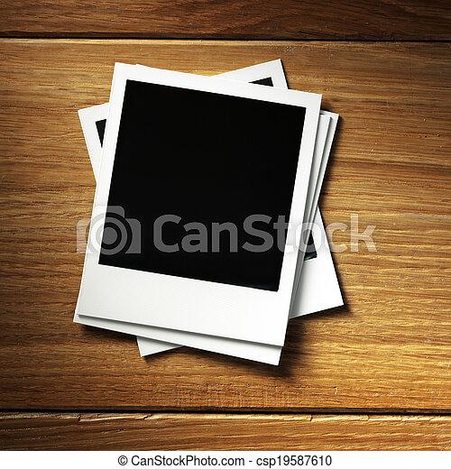 Polaroid style photo frame. Polaroid photo frame on wood background.