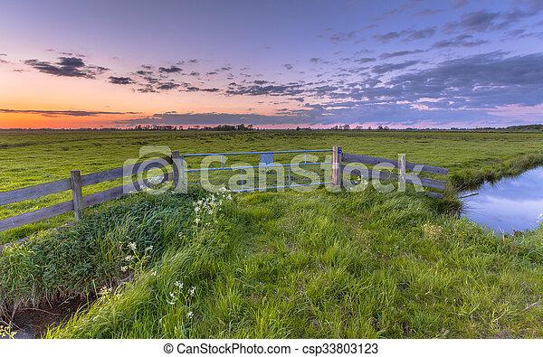 Polder landscape sunset - csp33803123