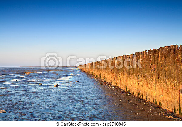 Poles in the ocean at sunset - csp3710845