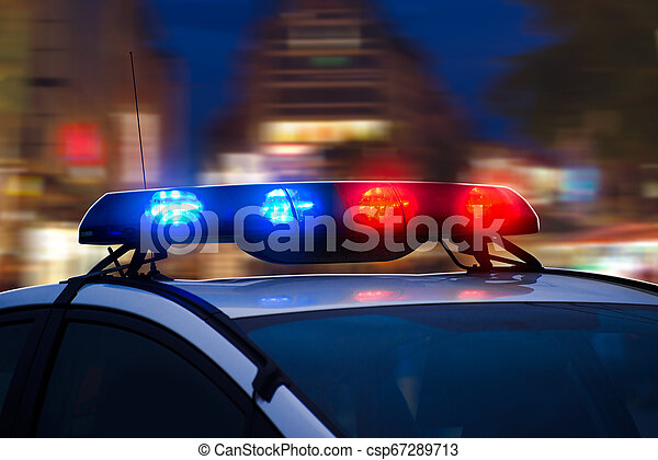 Police Car with Blue and Red Flashing Lights on the Street of Night City. Blurred background. - csp67289713