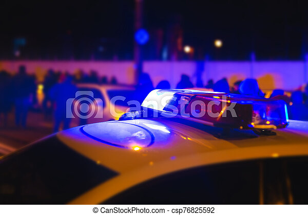 Police lights. Blue flasher on the police car at night - csp76825592