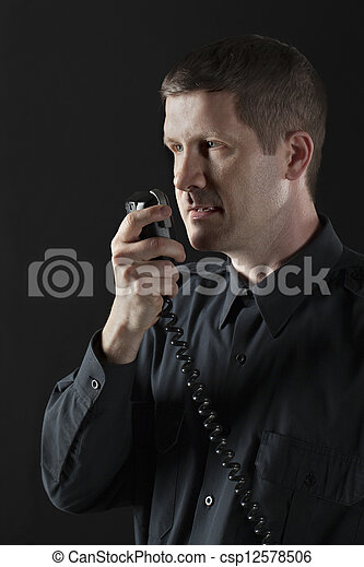 police officer talking to cb phone - csp12578506