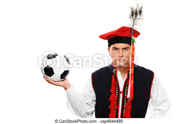 Polish man in a traditional outfit with football - csp4944480
