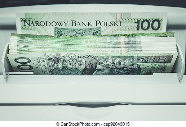Polish Zloty Banknotes Inside Bills Counting Machine - csp92043015