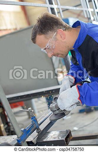 polishing a metal frame - csp34758750