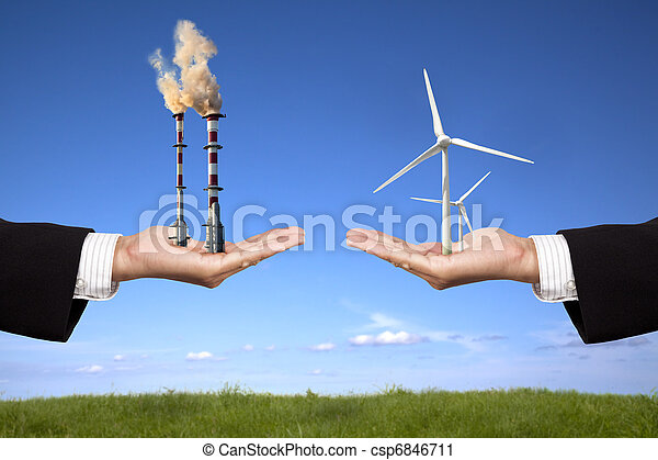 pollution and clean energy concept. businessman holding windmills and refinery with air pollution - csp6846711