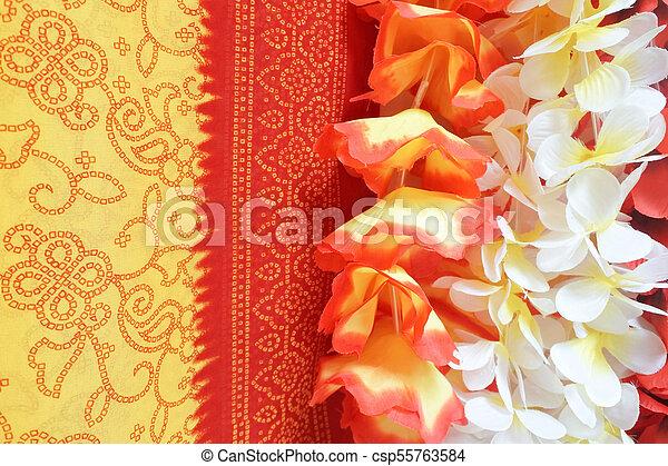 Polynesian Lei garland of flowers background - csp55763584