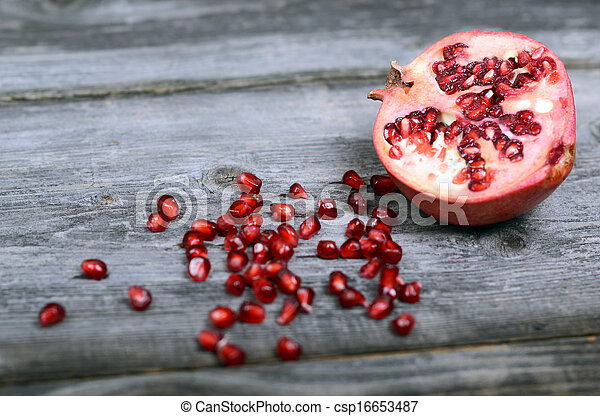 Pomegranate fruit on wooden floor - csp16653487