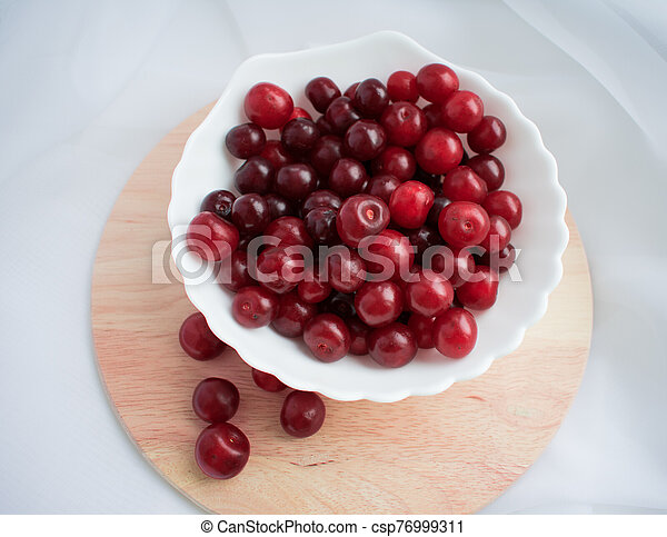 pomegranate on a plate - csp76999311