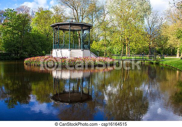 Pond and tulips in Vondelpark, Amsterdam - csp16164515
