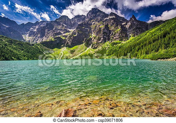 Pond in the mountains at sunrise - csp39071806